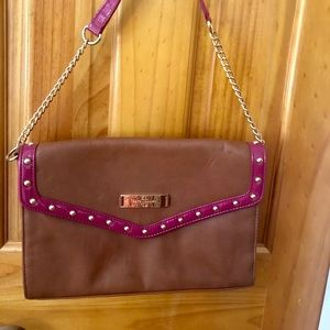 A brown and pink purse